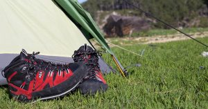 hiking boots at the entrance of a tent