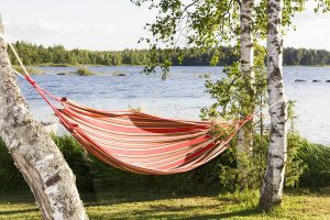 Hammocks are cooler than tents for comfortable summer camping.