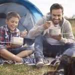 A father and son camping trip is a great escape in the modern world.