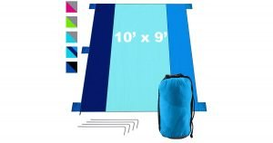 Blue sand free large picnic blanket shown with stakes and stuff bag.