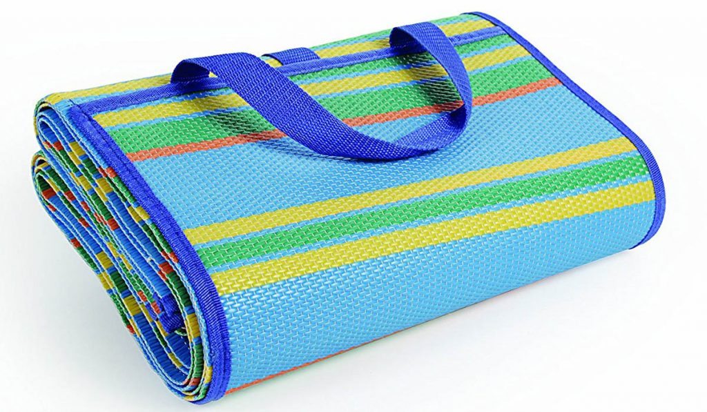 This handy Camco beach blanket folds into an easy to carry handbag.