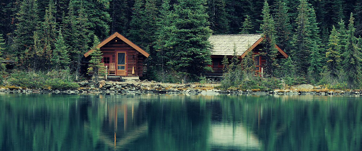 Two cabins on a lake in the woods