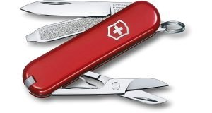 Red Swiss Army Knife Classic with nail file, scissors, and blade..