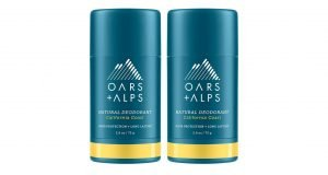 Oars + Alps Natural Deodorant blue container with white lettering.
