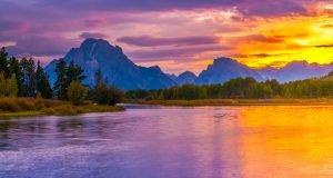 Sunset over lake in Grant Tetons National Park